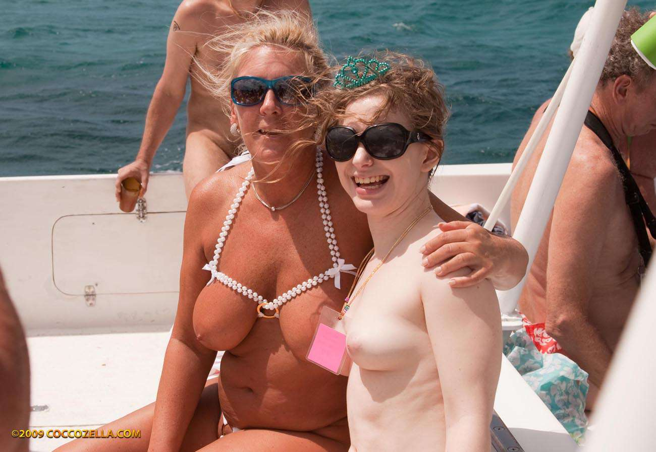 Nomad swimsuit naked catamaran sail