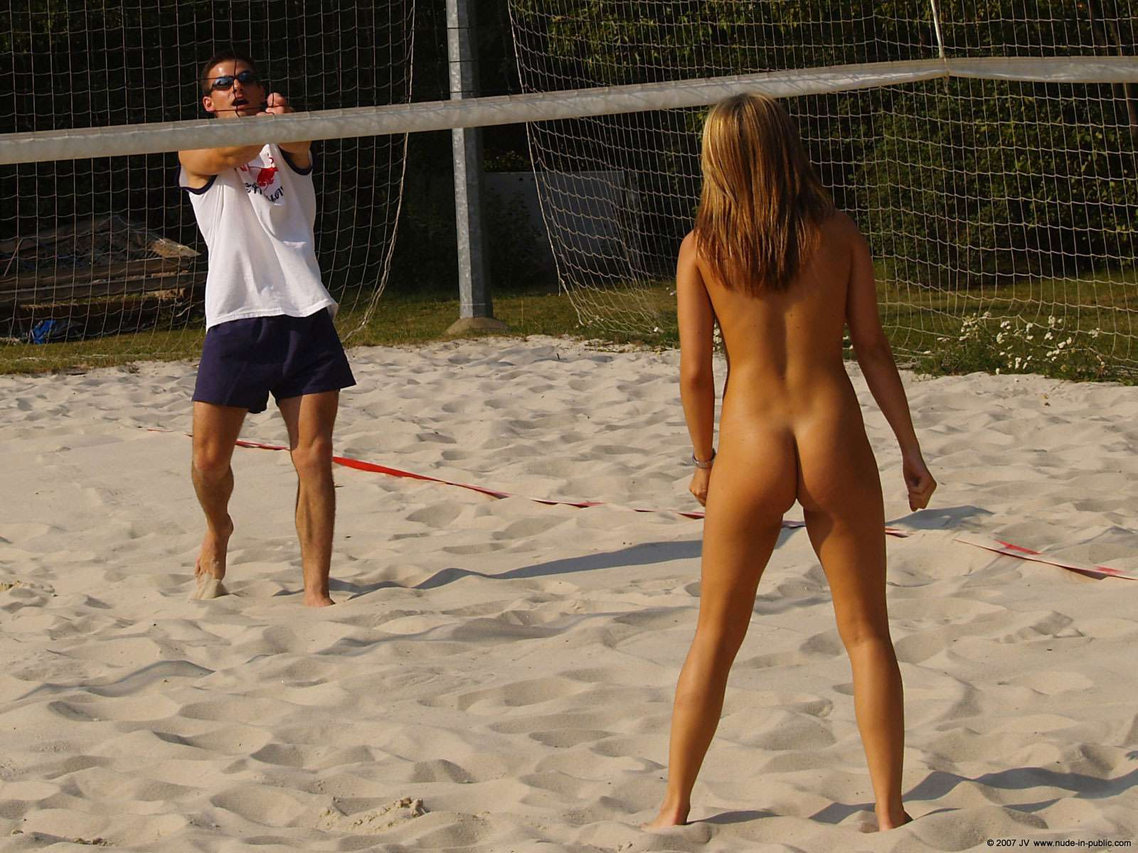 Nude womans playing xx volleyball