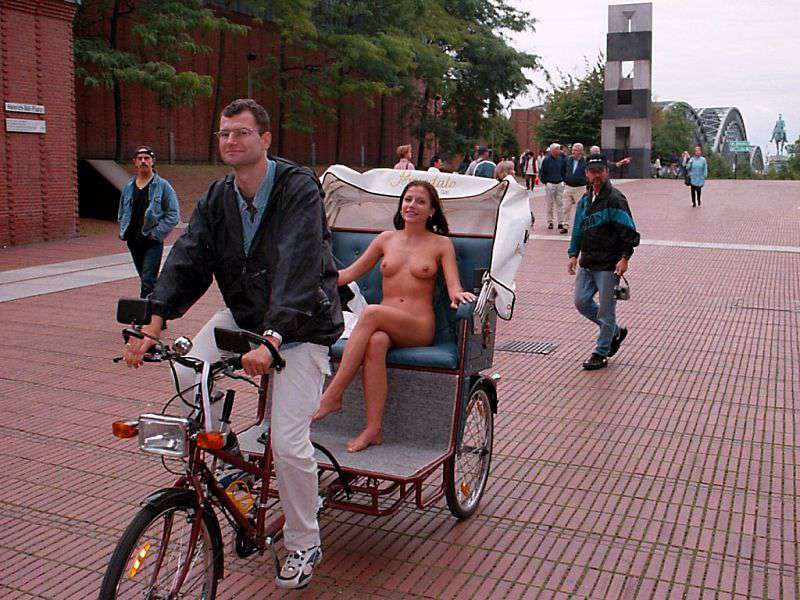 In a bicycle riksha in the city center